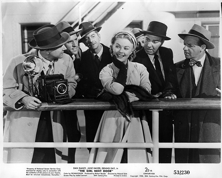 June Haver in a scene from The Girl Next Door (1953) appears to chat with a photographer and possibly reporters. The photographer has a Speed Graphic 4x5 camera. Others in the film were Dan Dailey and Dennis Day. (Still photo from my collection)