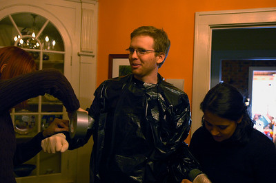 Brian suiting up in his garbage bag smock.  With Jayna (left) and Julia (right)