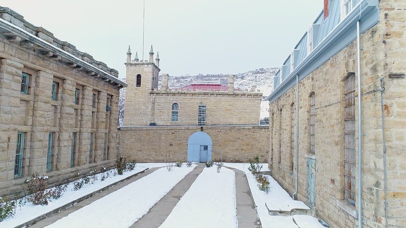 Entrance to the Idaho Old Penitentiary and aerial view of courtyard
