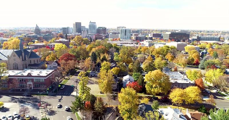 Moving toward the skyline of Boise Idaho with many autumn trees