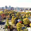 Moving toward the skyline of Boise Idaho with many autumn trees