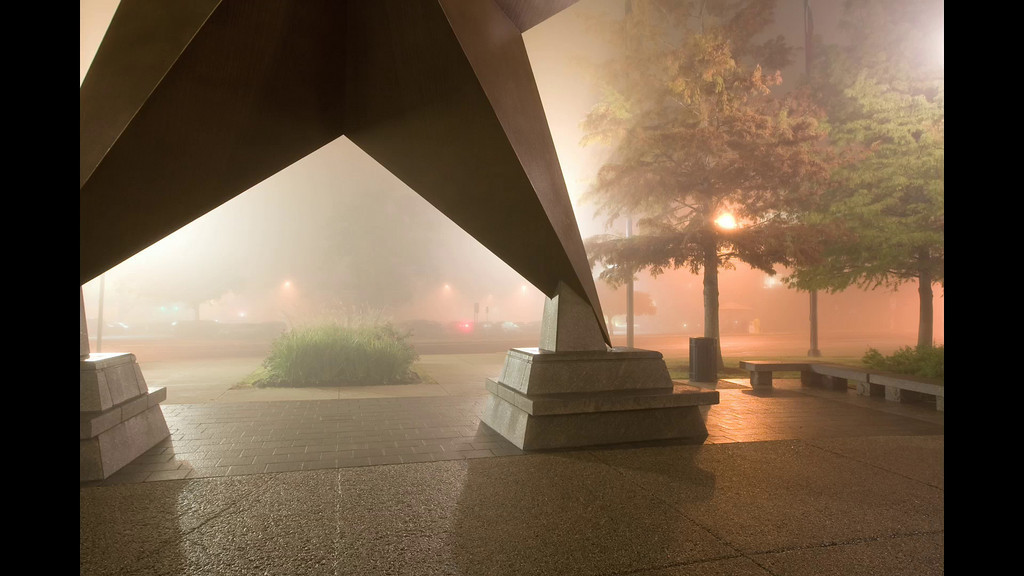 Bob Bullock Texas State History Museum<br /> Early A.M.<br /> 12/9/09<br /> <br /> <br /> Some Super! thick Fog rolled in on 12/9/09 and I headed over to the BBTSHM to get some shots in the cloak of the mist.  156 photos taken in a full circle, with the intent of creating a 360° interactive panorama.  This will have to suffice for now since the computing power to create it is monstrous.  Waiting to get Photoshop installed on the super Mac Pro at work so I can have a go.  The process consumes about 3GB of space and upwards of 3GB or ram!