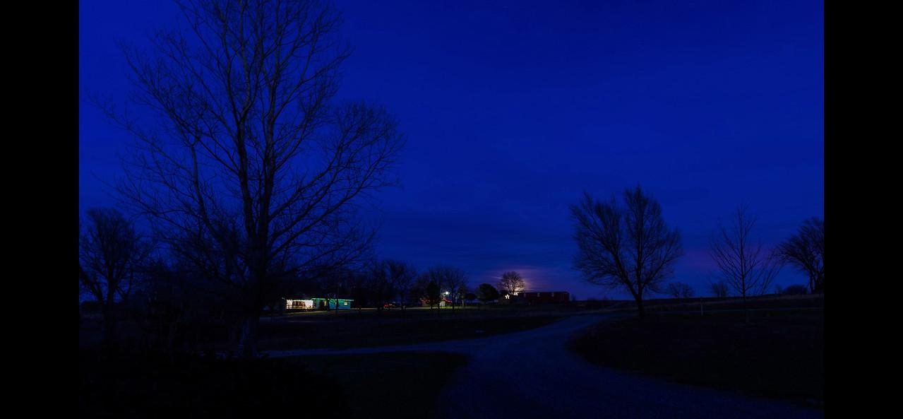 An almost full moon rises over my neighbor's barn, November 28, 2012.