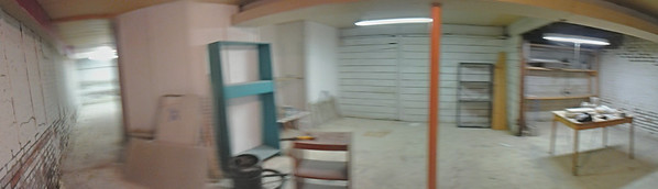 Panorama of front room in new space's basement.