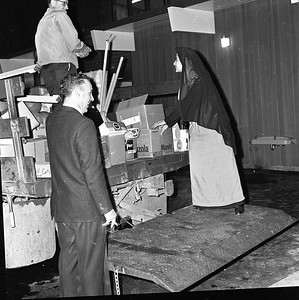 Sister Mary Olivia, principal of St. Bernard's Elementary School, gets assistance from Charles Edwards, left, and Paul Owens in the moving of school supplies and equipment. (Times-Standard file photo)