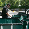Fitchburg State University has opened for students this year but will be at 65% capacity and Fall sports have been cancelled. Senior Anthony De Freitas from Groton cleans the bins that students are using to carry their belongings to their new dorm rooms on Tuesday morning. SENTINEL & ENTERPRISE/JOHN LOVE