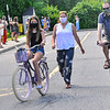 KRISTOPHER RADDER — BRATTLEBORO REFORMER<br /> Vivien McLoughlin, a graduating sixth-grader from Academy School, in Brattleboro, Vt., rides her bike with her family as teachers cheer for her during a graduation ceremony on Friday, June 12, 2020.
