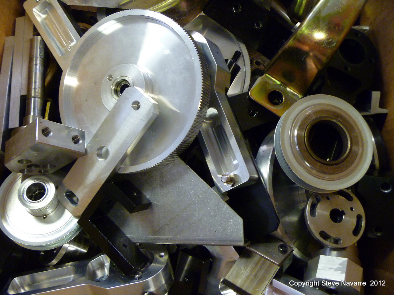 Bunches of custom made aluminum gears and parts.