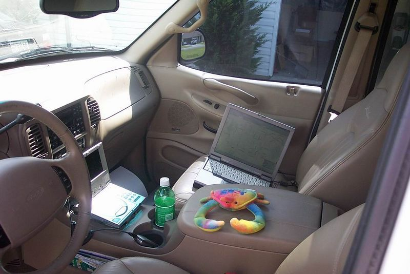 Crabs in the mobile office. Cell, DVD, V1 radar detector, laptop and GPS.