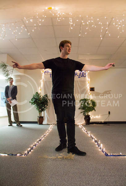 Preforming his talent of becoming a tree, Sean Marshall participates in the talent portion of the competition. The Mr. Haymaker 2018 competition was held Feb. 19 in Haymaker Hall. (Andrea Klepper | Collegian Media Group)