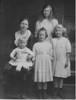 Wooldridge family, no date but probably early 1919, since Susan E. Wooldridge (b. July 1919) is not in photo. <br /> Back: Susan Abbott Wooldridge, Margaret A. Wooldridge (Peg Fifer) age about 12.<br /> Front: William Wooldridge (Bill), age about 18 mo., Mary W. Wooldridge (Beyer), age about 8, Alice F. Wooldridge, age about 10.<br /> Scanned 00708, gamma enhancement for contrast.