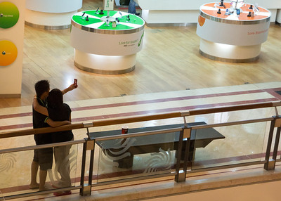 A couple photographing themselves at a Mall in Kuala Lumpur