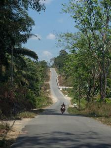 Motorbike rider at a kampung