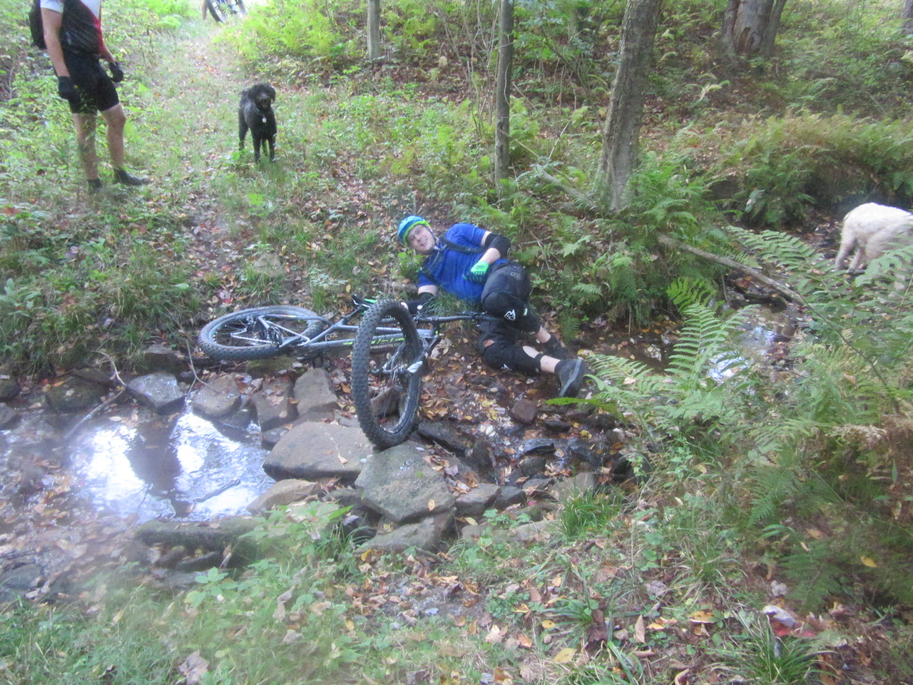 """Zack decided that we all needed to learn how to do a great """"slow motion endo"""" and he did a wonderful one for us as he rode into this small creek."""