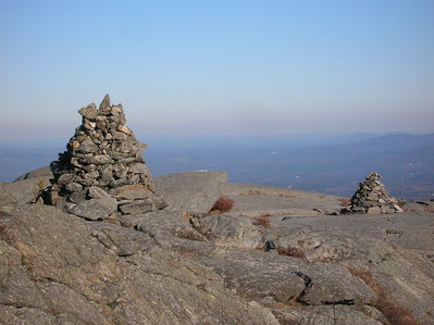 Reaching the summit, we were greeted by windy blasts of cold air and monumental cairns serving as trail markers
