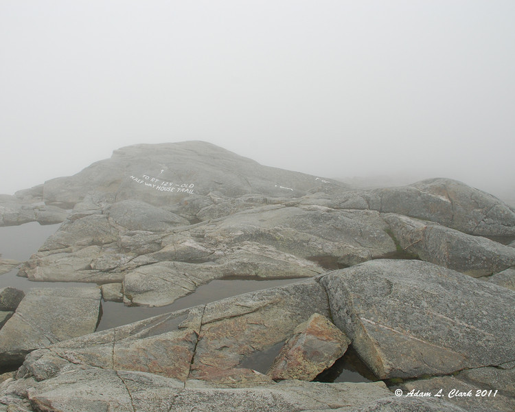 Looking West from the clouded in summit