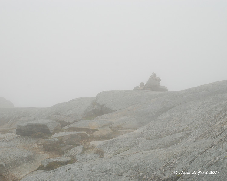 A cairn in the clouds