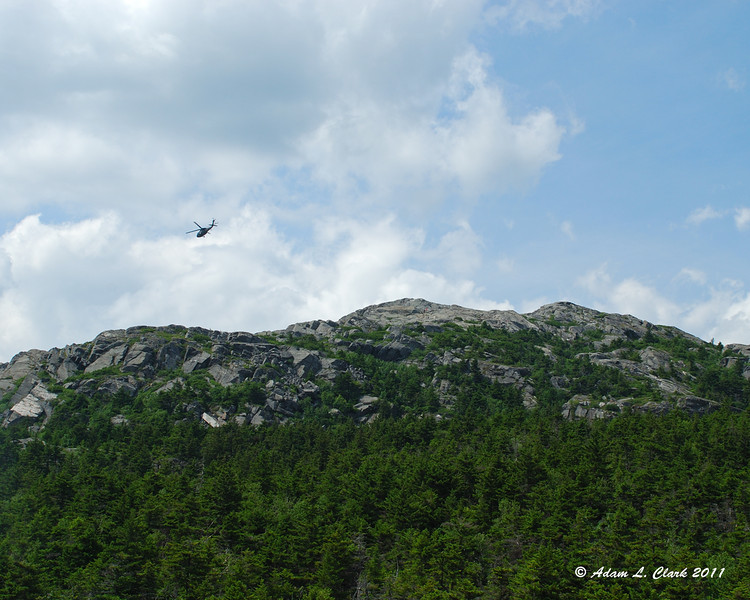 The helicopter flying past the summit