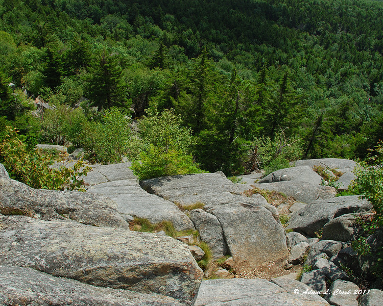 Looking down the steep open rock section of trail