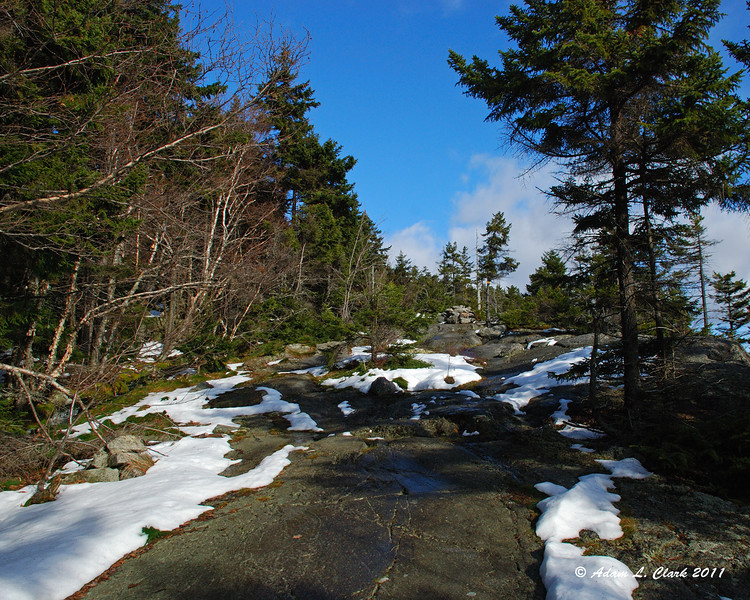 An open section of the trail with a little snow