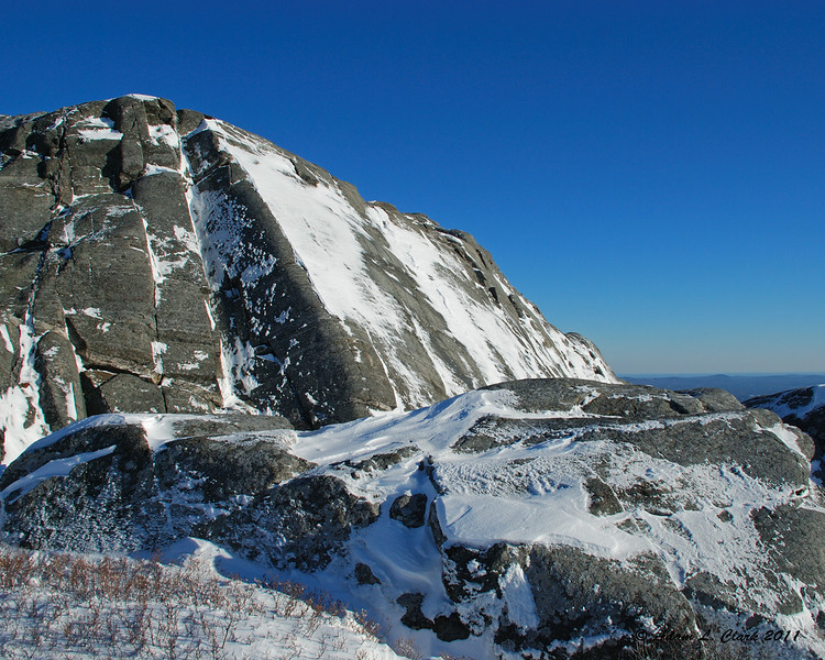 The rock face containing Billings Fold covered with snow
