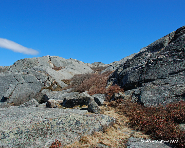 Looking over the bare rock that now surrounds the trail