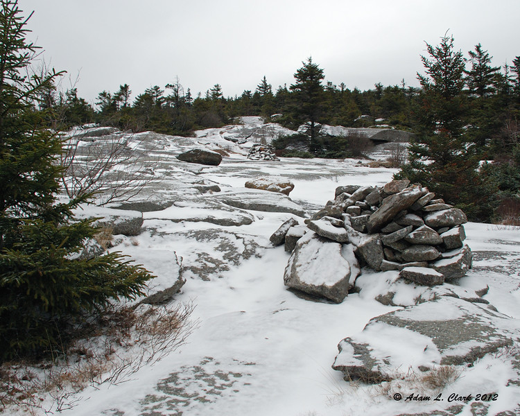 Heading up the trail over the open rocks near the junction with the Marian Trail