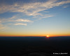 The sun going below the horizon