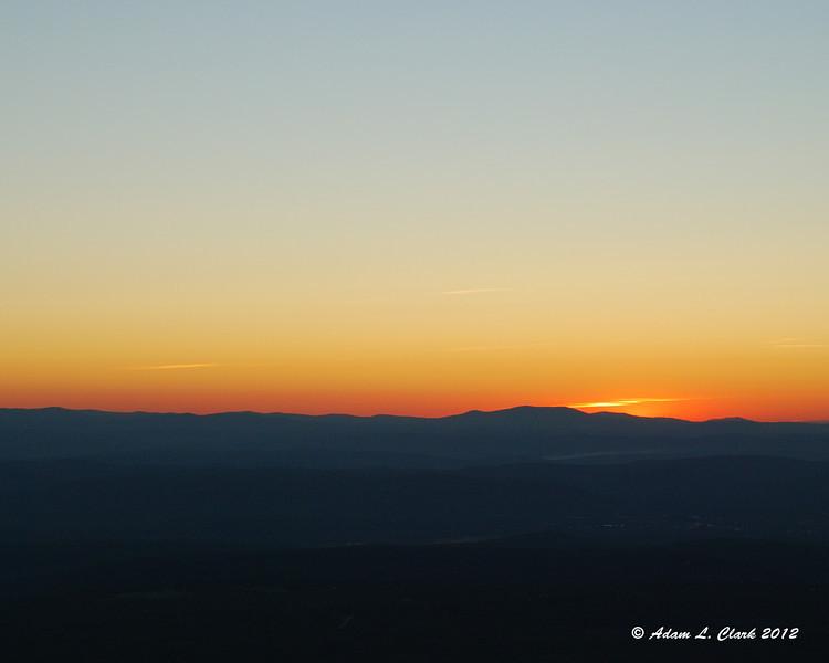 Dark orange on the horizon