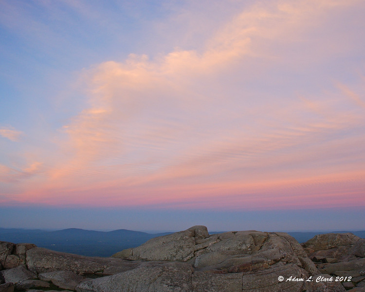 Colorful banded clouds over the summit