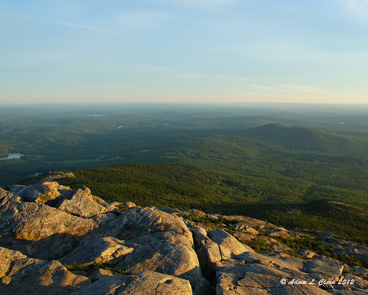 View to the south nearing sunset.  Bald Rock on the left, Monte Rosa on the right and Gap Mountain behind