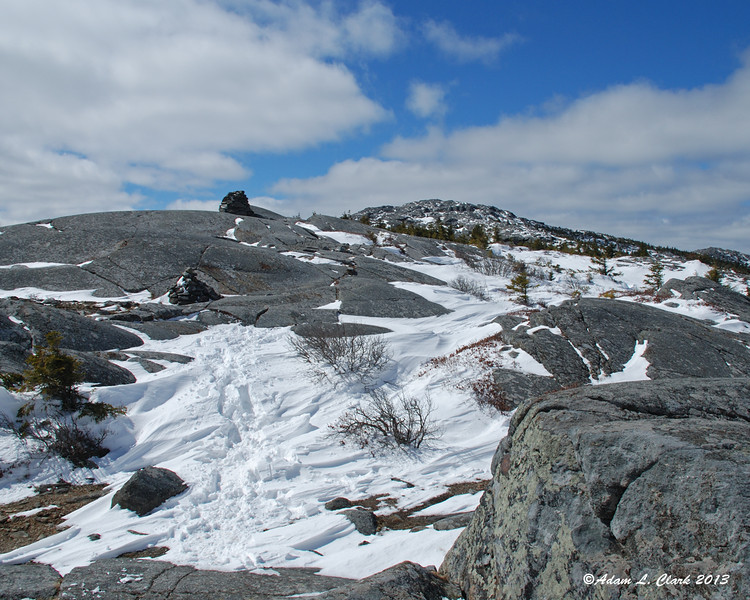 Nearing the summit now with drifted snow and exposed rock