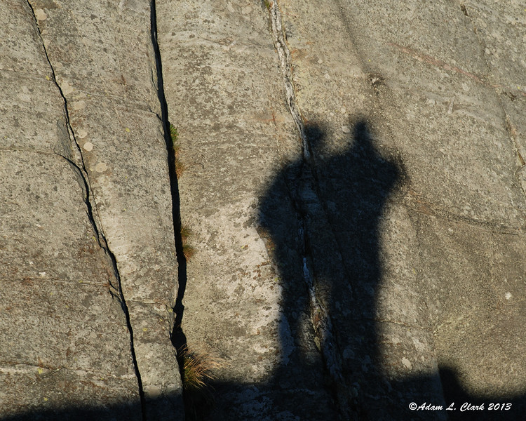 Melissa's and my shadow cast onto the rocks