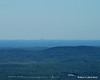 Boston can be seen in the distance, 64 miles away