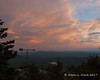 Color in the skies behind the weathervane
