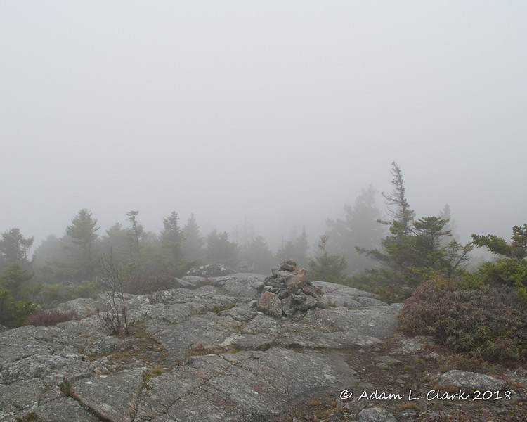 Hiking along the trail through the clouds