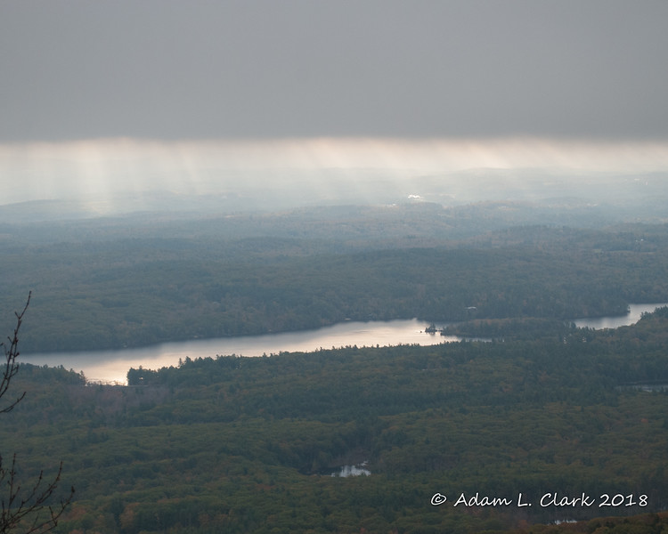 A small patch of sun rays trying to get through the clouds