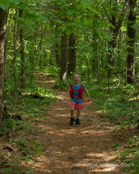 On the trail ahead of me looking back to me