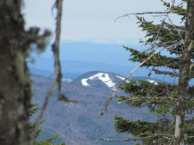 Top of Bretton Woods Ski Area with another ski area in far distance.