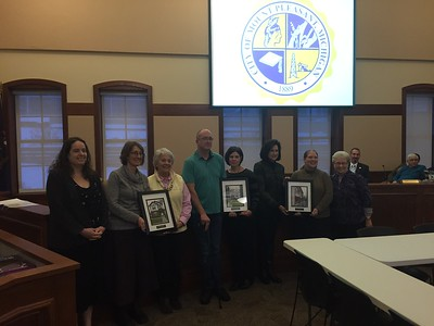 Three Community Improvement Awards were presented at the Mt. Pleasant City Commission meeting Monday, March 13, 2017. Shown, from left, are Planning Commission Chairwoman Lesley Hoenig; Michelle Buccilli and Phyllis Marshall from Marshall Real Estate Investments; Matthew and Robin O'Dell; Linda Morey and Amy Powell from Art Reach of Mid Michigan; and Mt. Pleasant Mayor Kathy Ling.