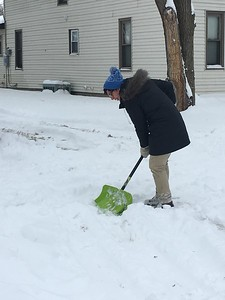 Kullen Logsdon - The Morning Sun Resident remove snow from driveways and sidewalks following severe snowfall in Mt. Pleasant on Mon., Dec. 12, 2016.