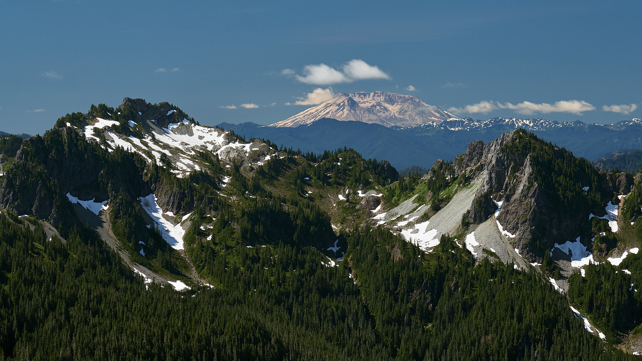 Mt St Helens viewed through the Tatoosh range from the Skyline trail on Mt Rainier.