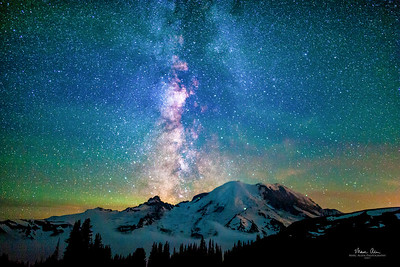 Mt Rainier as seen from just above Sunrise Visitor Center, about 2:15 AM on July 21, 2017. Climbers on the Emmons Glacier and Disappointment Cleaver routes are visible. This picture also features significant airglow: https://en.wikipedia.org/wiki/Airglow