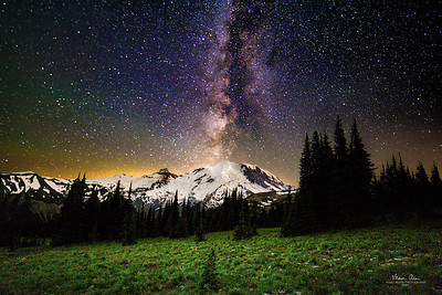 Mt Rainier as seen from just above Sunrise Visitor Center, about 2:45 AM on July 23, 2017. Climbers on the Emmons Glacier and Disappointment Cleaver routes are visible. This picture also features some airglow: https://en.wikipedia.org/wiki/Airglow