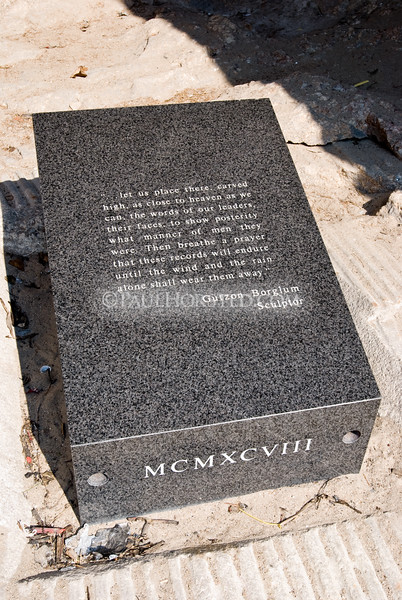 A granite capstone lies over a chamber (containing a titanium box) carved in 1998 in the floor of the Hall of Records at Mt. Rushmore. The box contains sixteen porcelain enamel panels. On these panels are written the words of the Constitution, the Declaration of Independence, a history of how and why Mount Rushmore was carved, a history of the four presidents with quotes from each, a biography on Gutzon Borglum, and the history of the United States. The inscription on the capstone comes from Gutzon Borglum's speech at the 1930 dedication of the Washington figure.