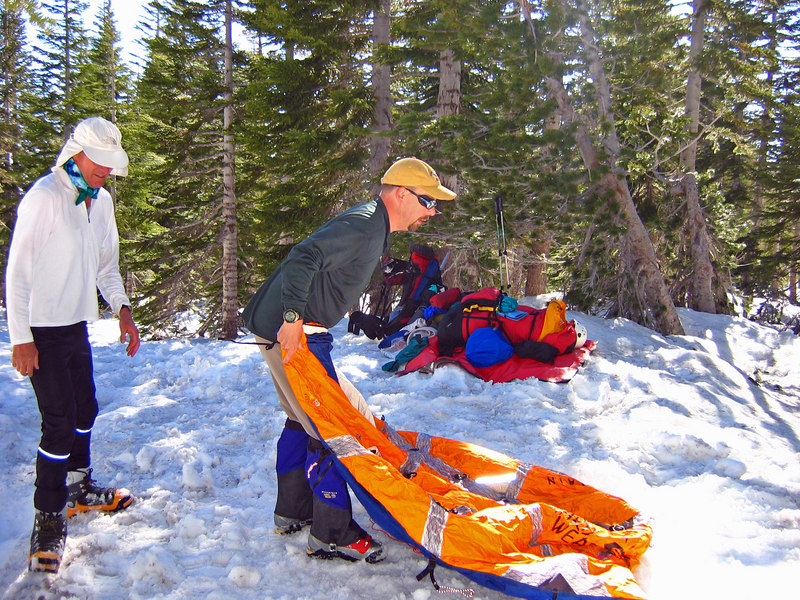 John gets tent ready on the snow. For the next coup[le days we eat, sleep and rest on the snow.
