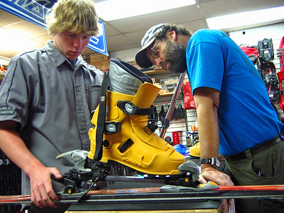 Pitr checks out ski equipment as clerk gets things ready at  The Fifth Season in the town of Mt. Shasta.