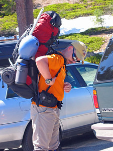John Von adjusts straps on his pack.