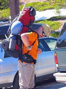 John Von adjusts straps on his pack.