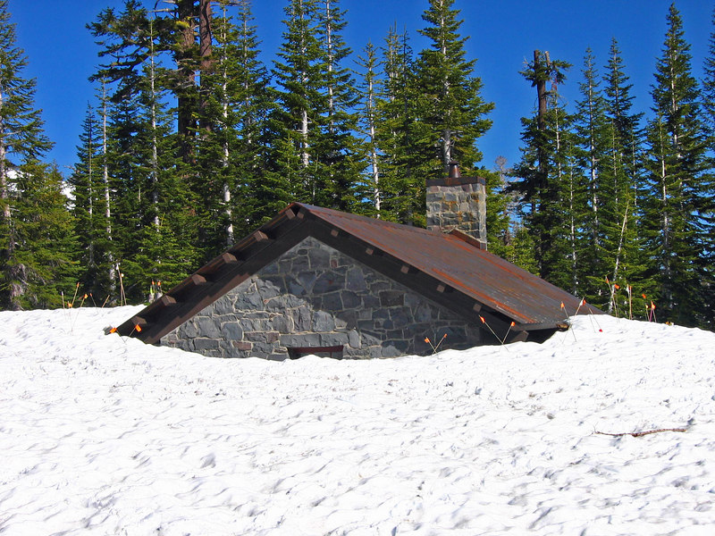 Historic cabin at Horse Camp is buried in snow this year.